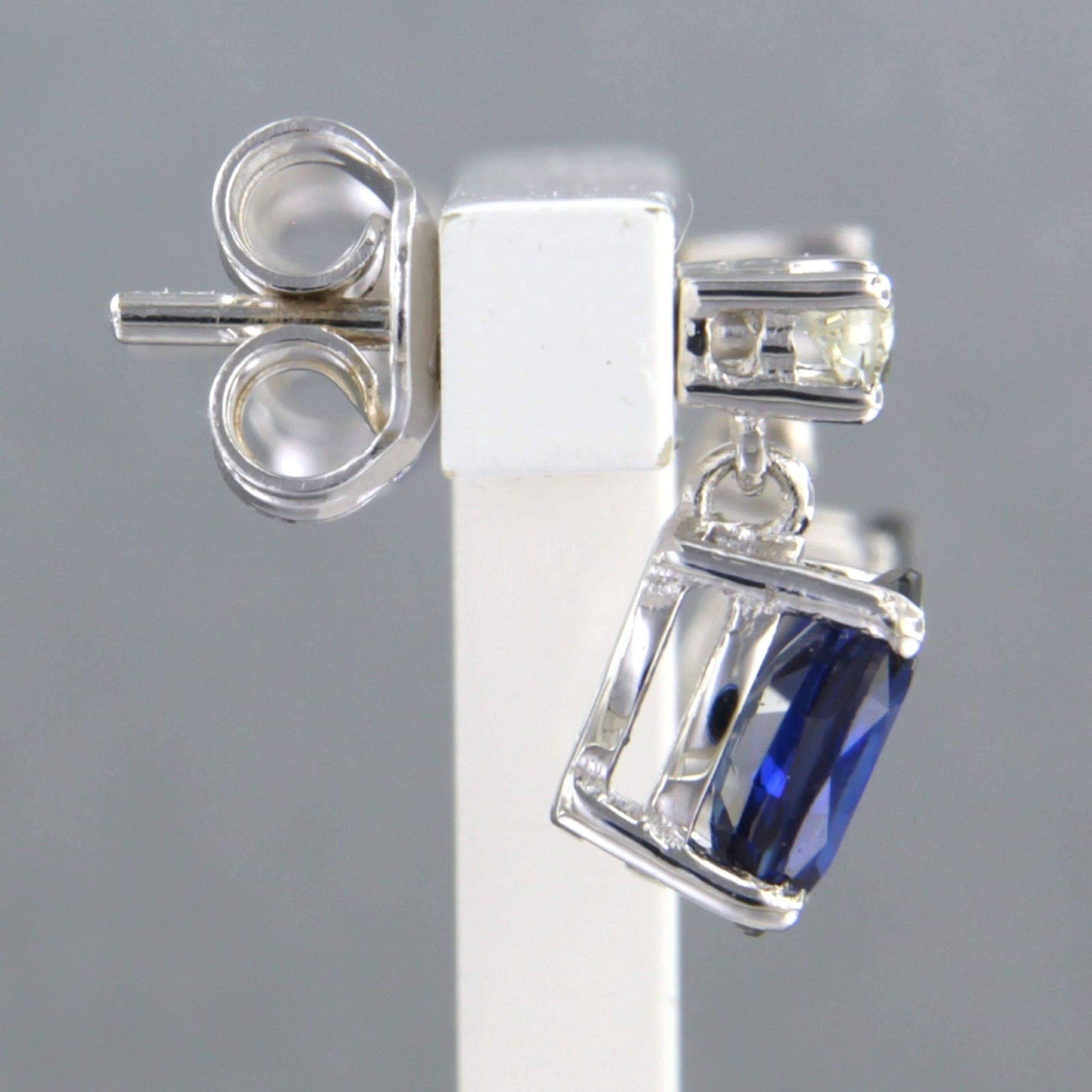 18k witgouden oorknoppen met saffier tot. 2,15ct en diamant 0.12 ct kopen? Bied vanaf 420!
