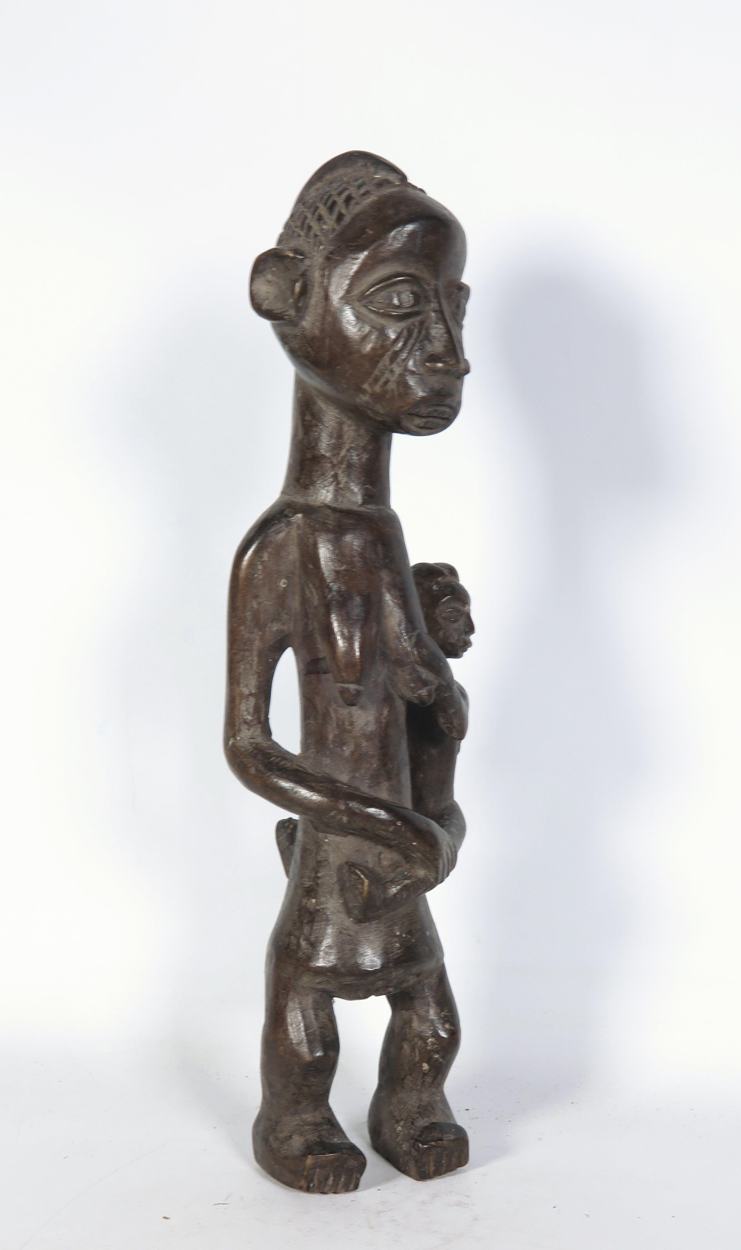 Yoruba - Houten beeld van moeder met kind op heup kopen? Bied vanaf 1!