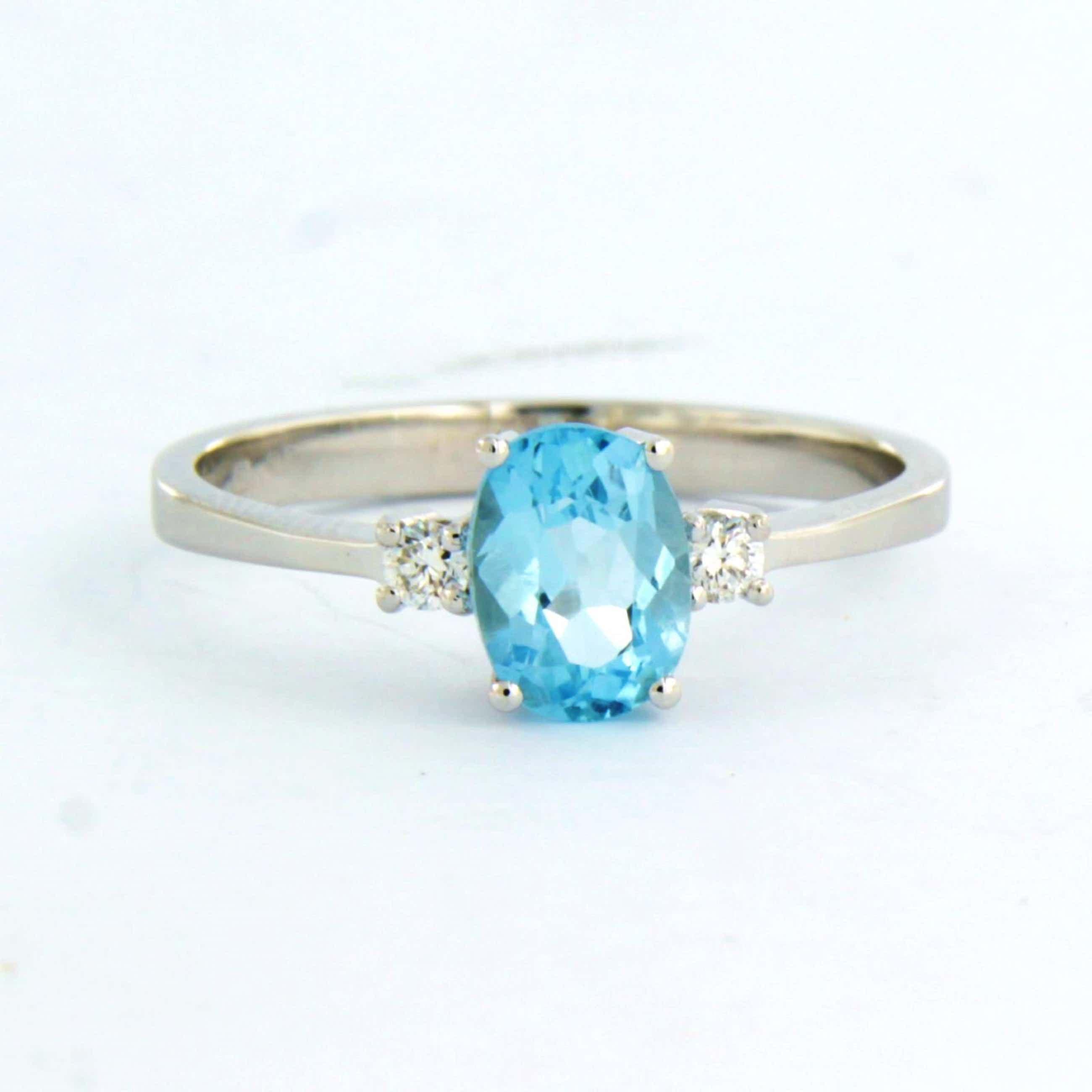 18k witgouden ring bezet met blauwe topaas en briljant geslepen diamant kopen? Bied vanaf 240!