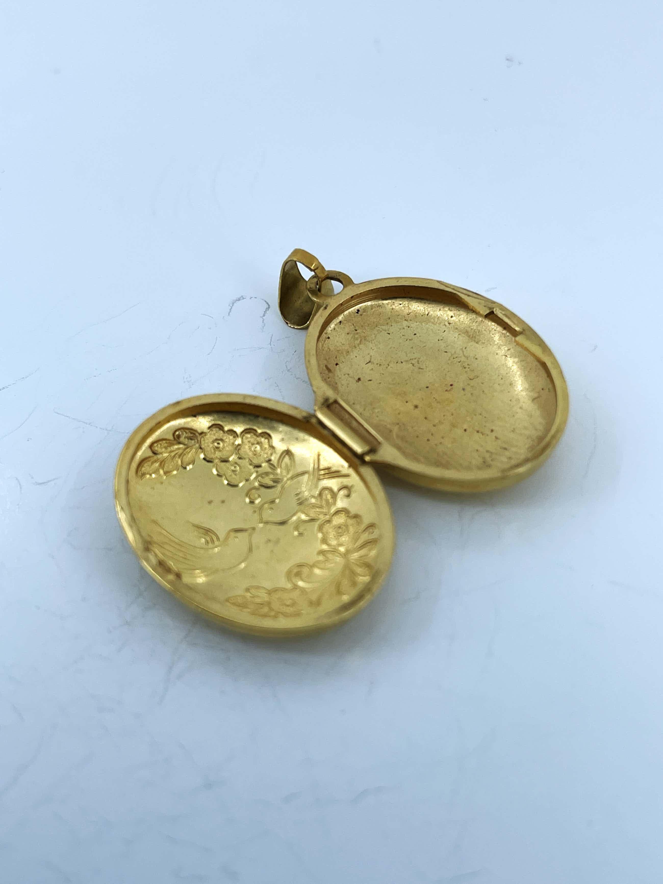 18kt gouden medaillon fotohanger  2,28 gr kopen? Bied vanaf 120!