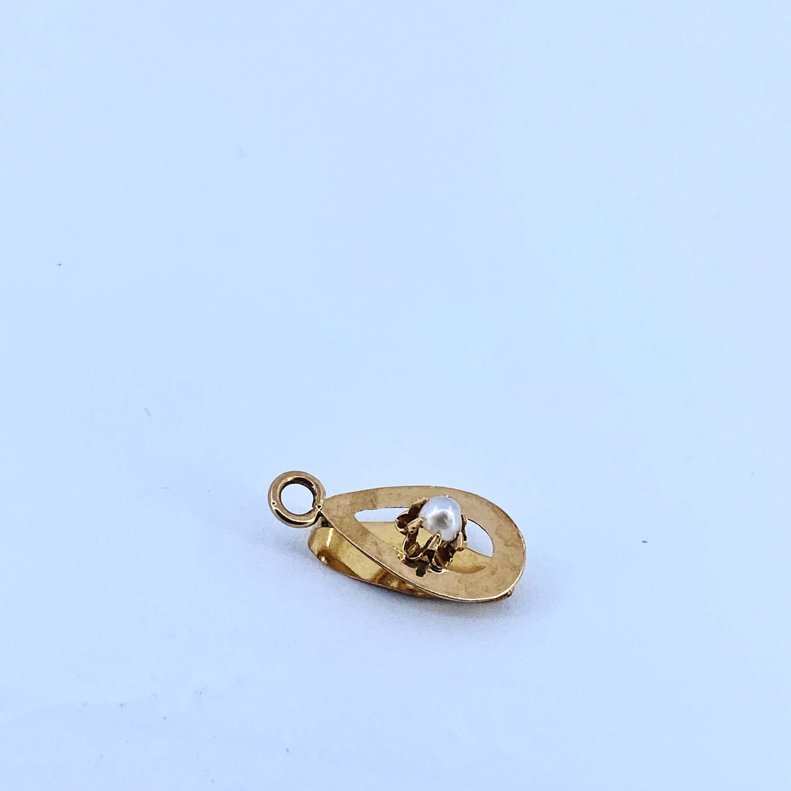 18 kt gouden hanger met cultivé parel, 0,61 gram kopen? Bied vanaf 52!